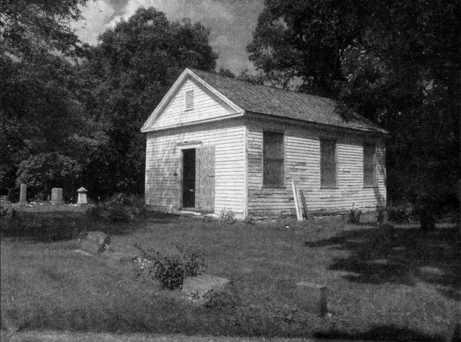 Newspaper black and white photo of the church at East Richmond Cemetery