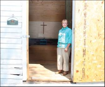 Above: Georgia Kestol-Bauer stands in the doorway of Hart Prairie Methodist-Episcopal Church in the town of Richmond. Kestol-Bauer is putting a lot of personal time and financing into restoration of the historic church.