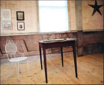 A letter and photos from the 1850s, including a portrait of Kestol-Bauer's relatives, hang on the original walls of the church. An original table and chair sit on the renovated church floor.