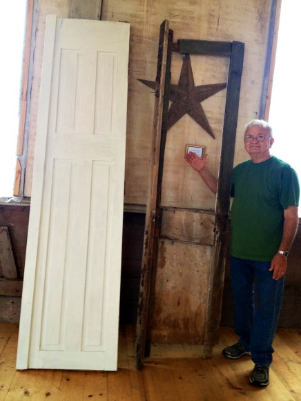 Larry Yanke and Original Church Doors. One is repaired and painted. The other is jus the frame.